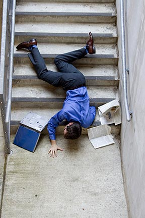 This picture is a simulation of what it may look like when a man falls down stairs. Slip and fall accidents, sometimes referred to as trip and falls, are covered by an area of law called premises liability. Contact a Kenner premises liability attorney today to represent you in your slip & fall injury claim.