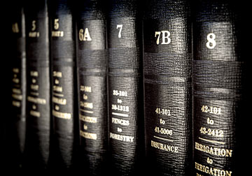 This image depicts books of law. Only a Kenner Governmental Liability Lawyer can advise you of your rights against the government. Contact a Kenner Government Liability Lawyer today to discuss a potential lawsuit against the government.